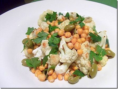 big bowl of roasted cauliflower chickpea salad topped off with fresh ...